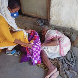 Blanket distribution at Kalahandi, Orissa