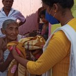 Blanket distribution at Kalahandi, Orissa